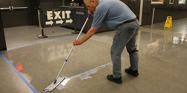 Spreading floor finish