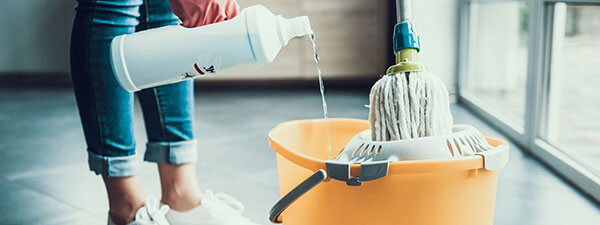 pouring disinfectant cleaner into mop bucket